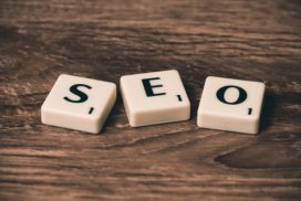Scrabble letters on a table spelling out SEO