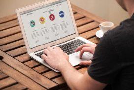 Man using website on laptop